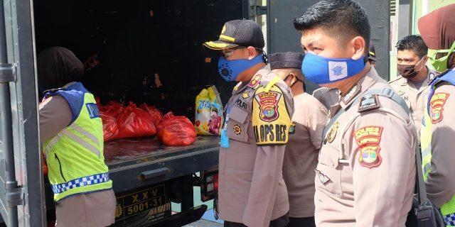 Polri Peduli Covid-19, Polres Lampung Utara Bagikan 1056 Paket Sembako